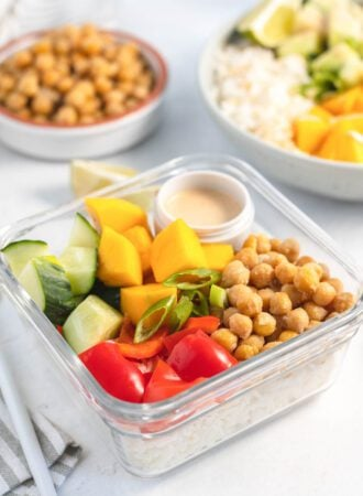 Chickpeas, veggies and rice in a glass food storage container.