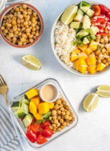 Overhead view of a meal prep container with chickpeas, rice and vegetables.