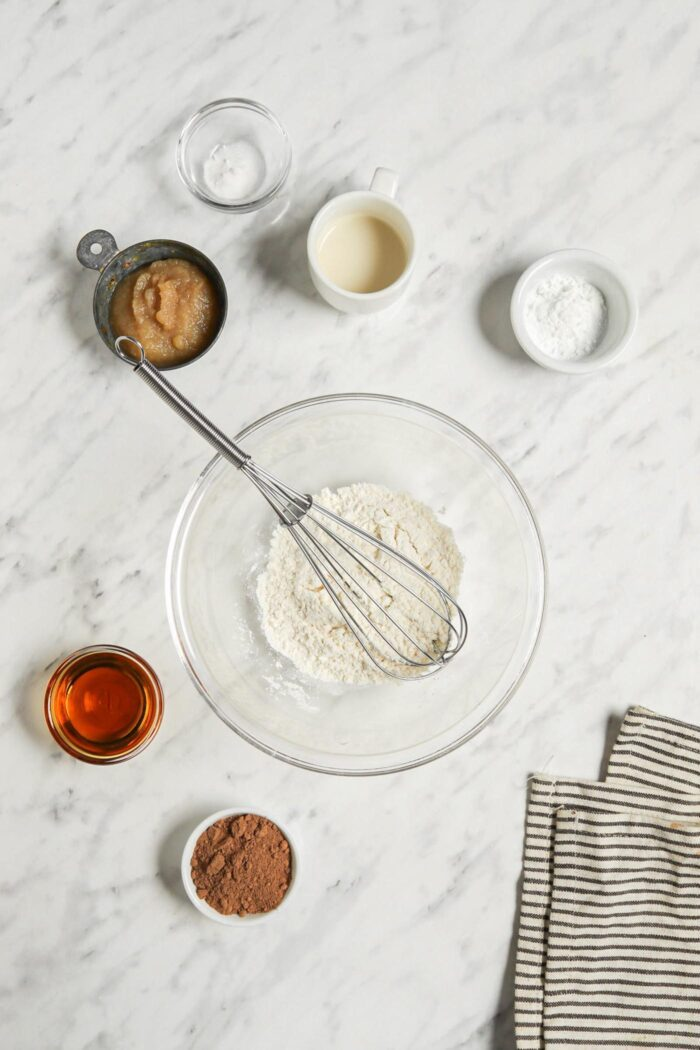 Dry baking ingredients mixed together in a glass mixing bowl.
