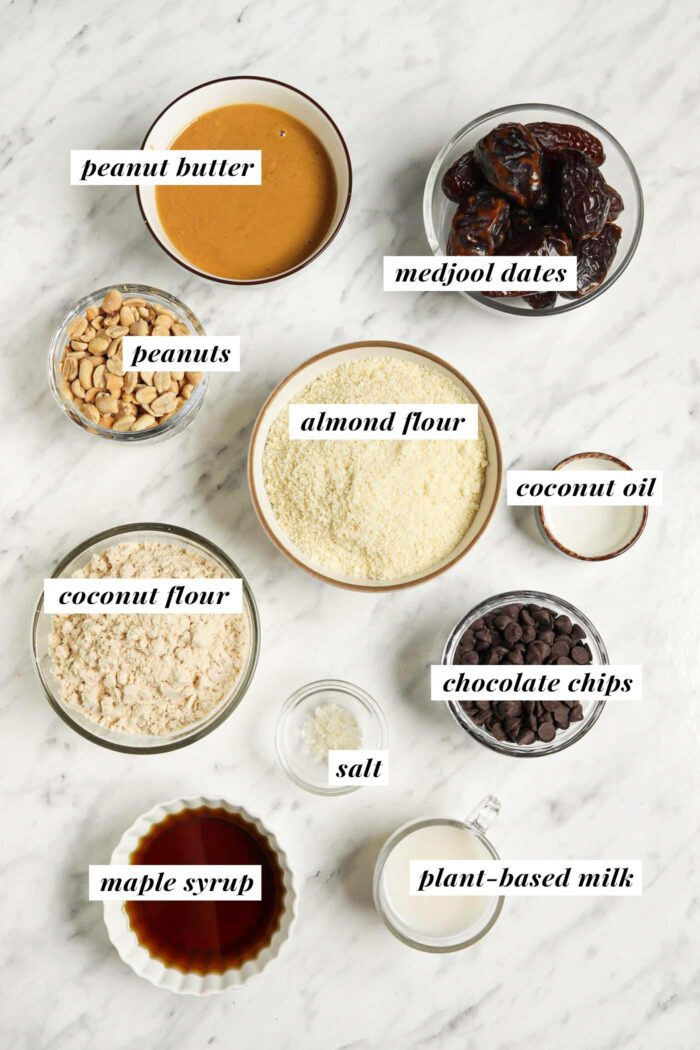 Visual of ingredients for making homemade snickers bars. Each ingredient is labelled with a text overlay.