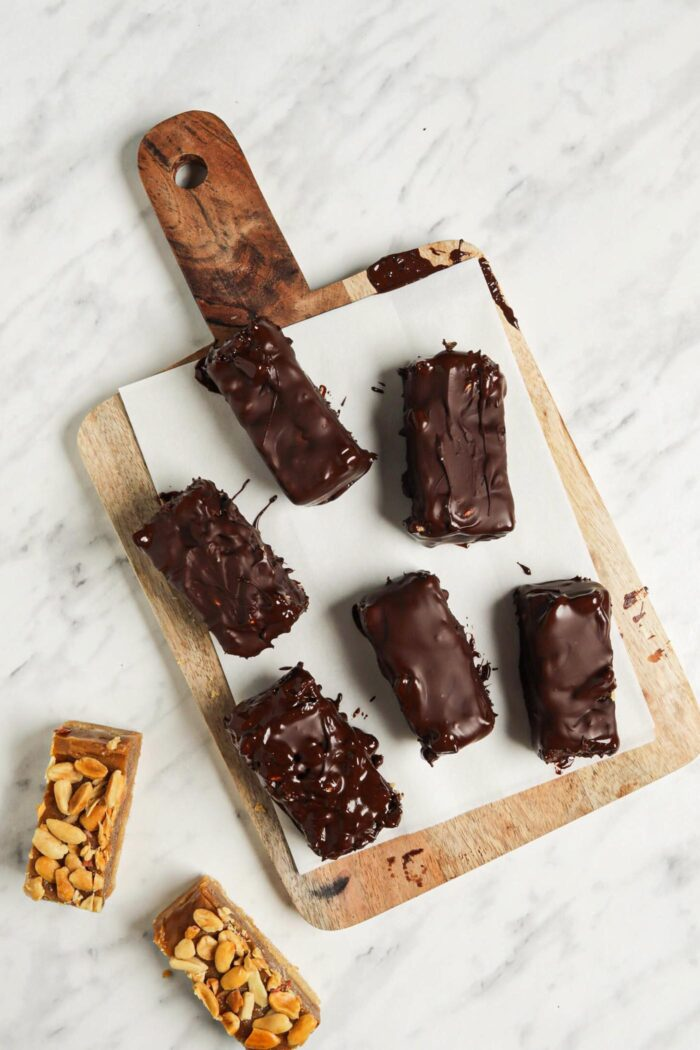 Chocolate candy bars on a cutting board.