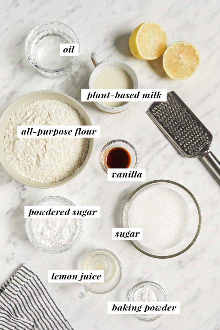 Visual ingredient list for making vegan lemon loaf cake with icing.