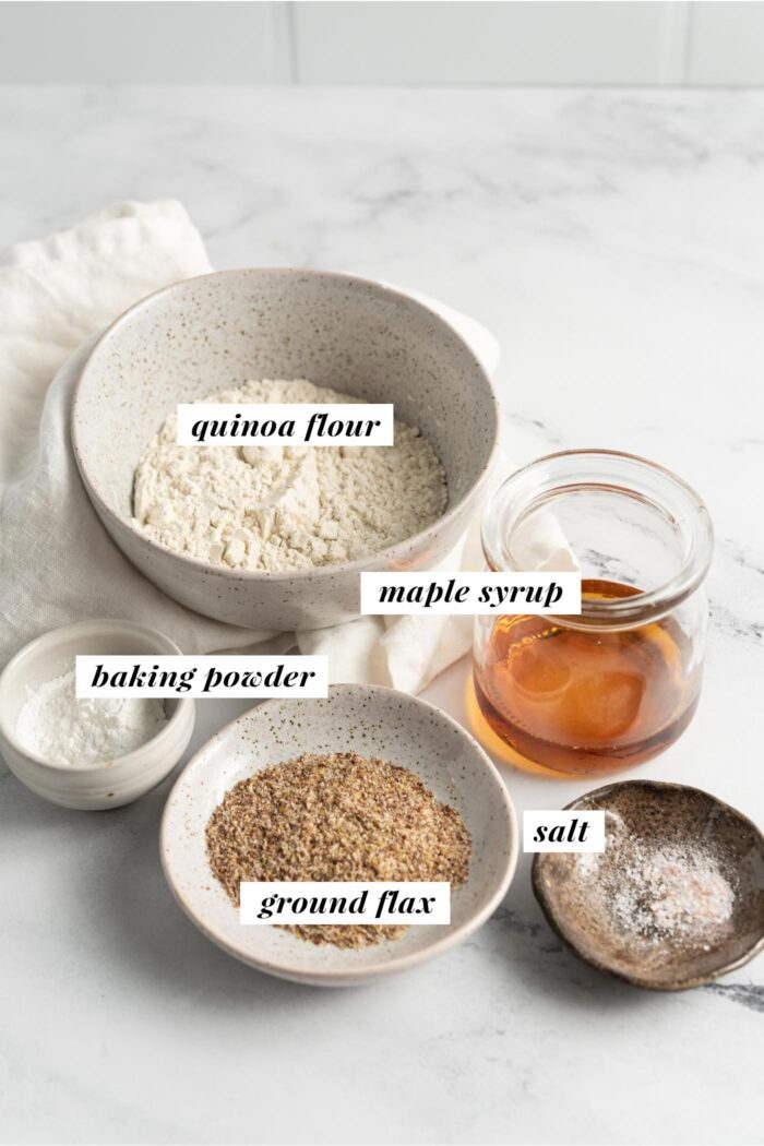 Visual list of labelled ingredients for making a vegan quinoa flour pancake recipe.