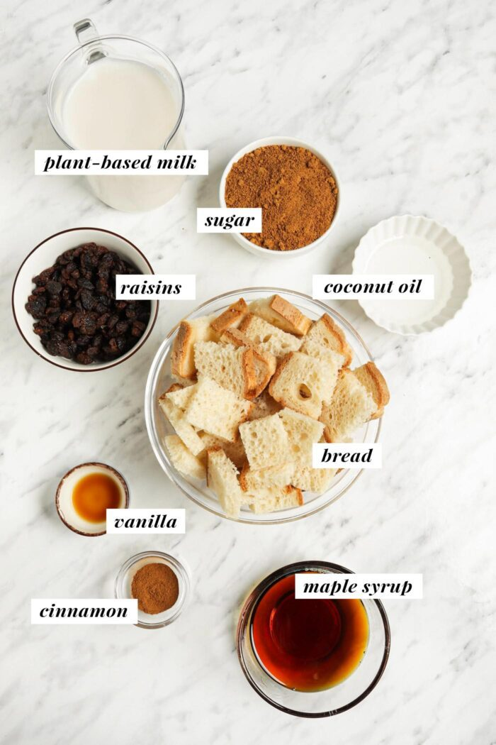 Visual list of ingredients for making easy vegan bread pudding. Each ingredient is labelled with text overlay.