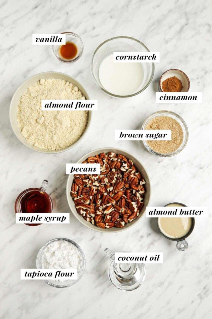 Visual list of ingredients for making gluten-free pecan pie bars.