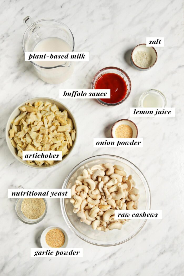 Visual list of labelled ingredients for making a vegan buffalo chicken dip recipe.