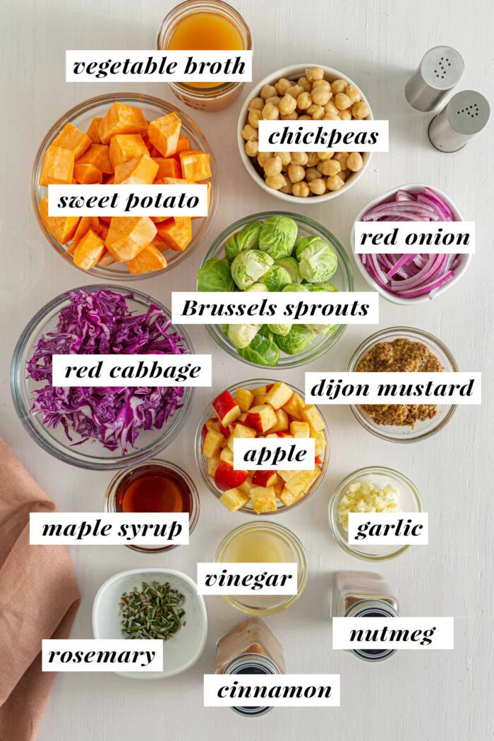 Visual ingredient list for making a cabbage, sweet potato, Brussel sprouts and chickpea skillet.
