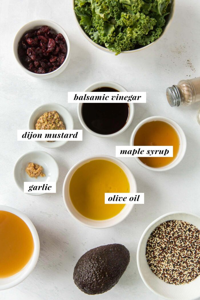 Visual list of ingredients for making a quinoa kale salad with maple balsamic dressing.