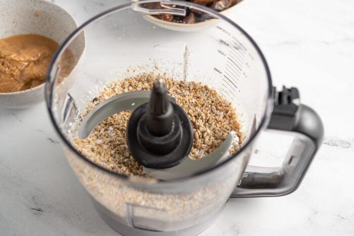 Blended sunflower seeds, coconut, hemp seeds and sesame seeds in a food processor.