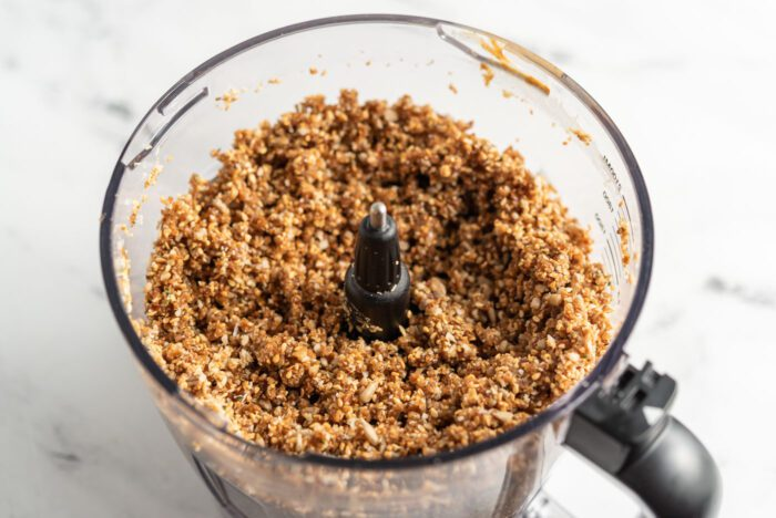 Sticky energy bar dough in a food processor.