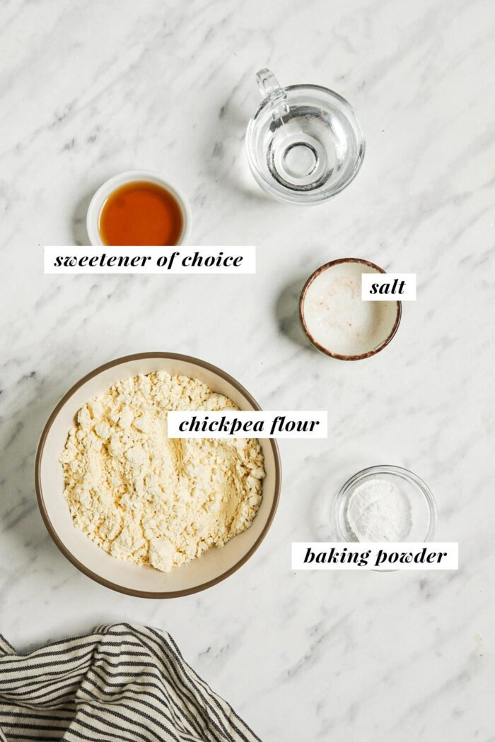 Visual list of ingredients for making a vegan chickpea flour pancake recipe. Each ingredient is labelled with text describing the ingredient.