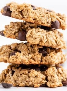 Stack of 4 chocolate chip cookies against a plain white background.